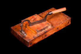 picture of tobaco leaf  - Antique tobacco leaves chopper isolated on black - JPG