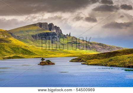 Landscape View Of Old Man Of Storr Rock Formation And Lake, Scotland