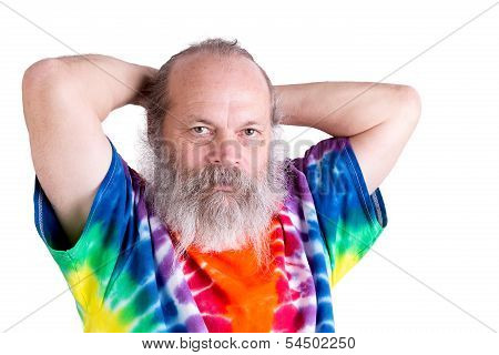 Senior Man With His Tie Dye T-shirt Holding His Hair On The Back
