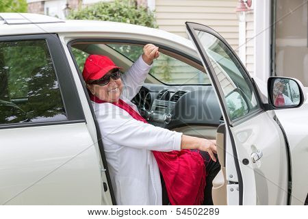 Senior Adult On The Passenger Seat Getting Ready For Trip