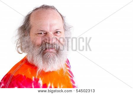 Happy, Friendly Baby Boomer Looking At You With His Tie Dye T-shirt