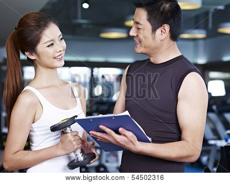 Young Man and Woman In Gym