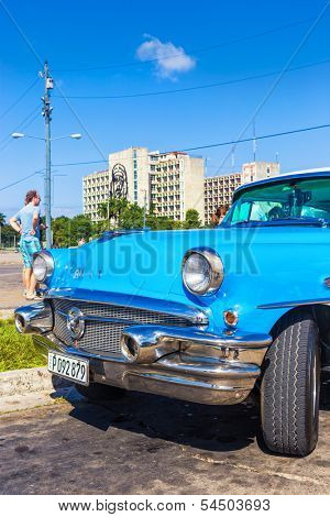 HAVANA-NOVEMBER 19:Classic Buick in the Revolution Square November 19,2013 in Havana,Cuba.These vintage cars,bought before 1959,are common in Cuba and have become a well known tourist attraction