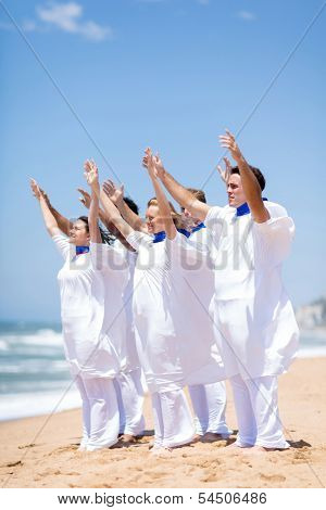 young church choir worshiping on the beach