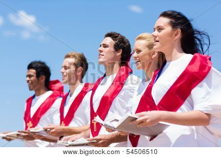 young church choir singing outdoors