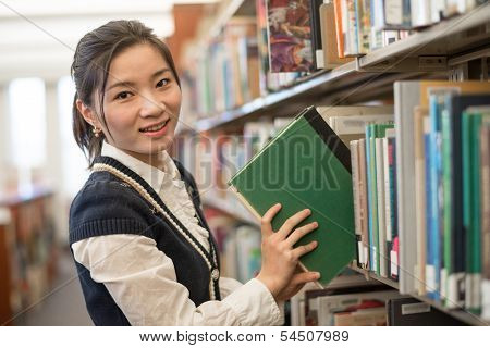 Woman Putting Book Back