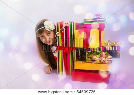 The teenage girl with bright Christmas gifts.
