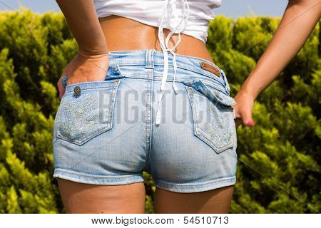 Woman in jeans shorts at the park