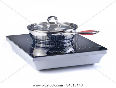 Frying pan at the induction stove over the white background