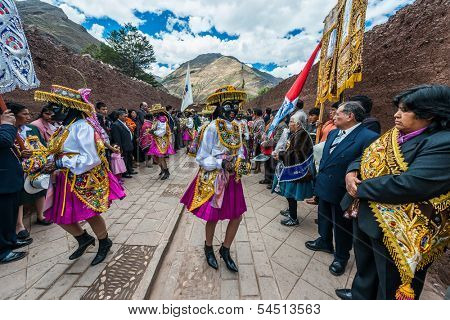 PISAC, PERU - JULY 16: Virgen del Carmen parade in the peruvian Andes at Pisac Peru on july 16th, 2013. The Virgin del Carmen festival is in July, and includes colorful costumed dancers and a parade.