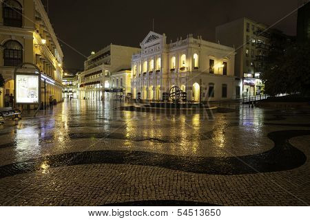 MACAU - OCTOBER 30: Night view in rain on the Historic Center of Macao - Senado Square on October 30, 2012 in Macau, China. Historic Center of Macao was inscribed on UNESCO World Heritage List in 2005
