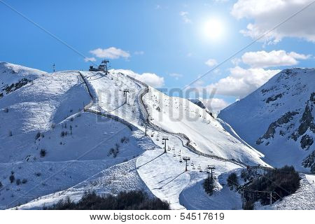 Mountains covered with snow and ski track on the slope in popular tourist resort of Limone Piemonte in Italy.