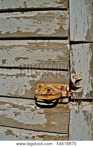 A rusty lock on an old door