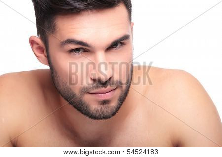 beauty face of an un shaved naked young man looking at the camera