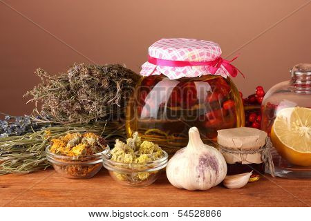 Honey and others natural medicine for winter flue, on wooden table on brown background
