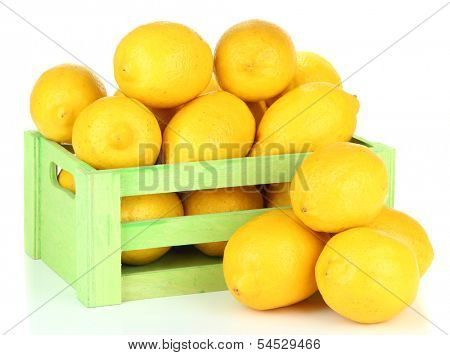 Ripe lemons in wooden box isolated on white