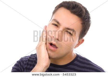 Young Casual Man With A Toothache Over White Background