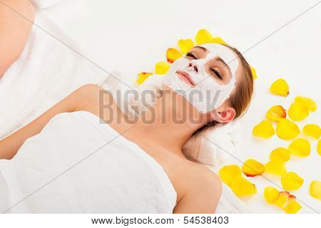 Therapist Applying A Face Mask