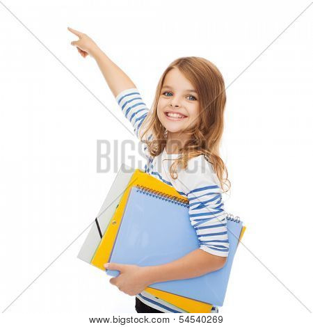 education, school and virtual screen concept - cute little girl with colorful folders pointing in the air or virtual screen