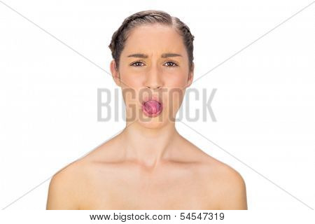 Healthy woman on white background sticking her tongue out
