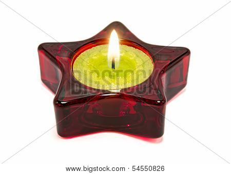 Nice green candle, inside a red star.