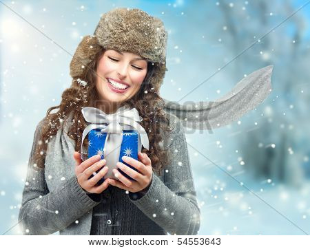 Happy Young Winter Woman With Christmas Gift. Gift Box Outdoors. Excited Girl With Holiday Present Laughing. Surprised Female. Snow