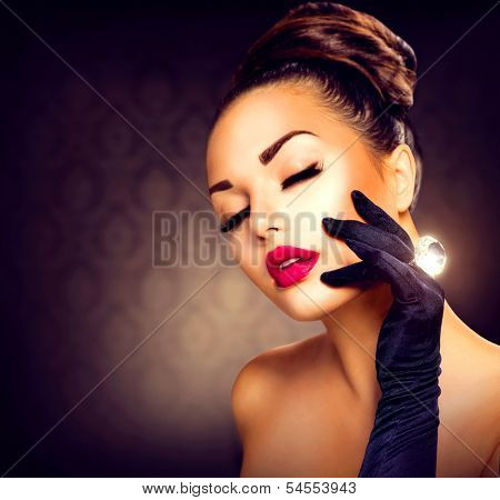 Beauty Fashion Glamour Girl Portrait. Vintage Style Girl Wearing Gloves. Jewellery. Jewelry. Glamor Hairstyle and Make-up. Diamond Ring. Retro Woman Portrait