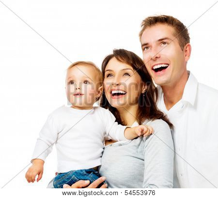 Happy Smiling Family Portrait isolated on White Background. Father and Mother with Little Baby Looking Up and Laughing. Parents with Child with Healthy White Teeth