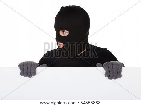 Thief Looking Around A Blank Sign
