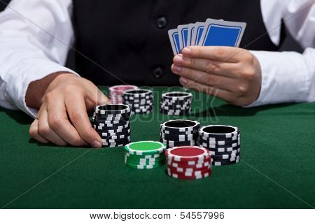 Poker Player About To Place A Bet