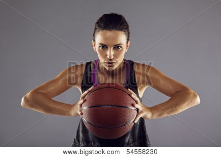 Female Basketball Player Passing The Ball