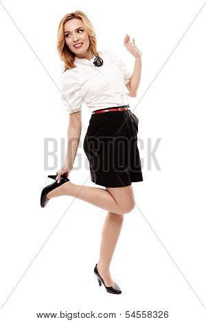 Attractive Blonde Wearing Black Mini Skirt And Holding Her Heel