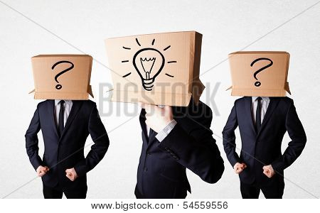 Group of handsome people gesturing with sketched ligh bulbs and question mark on box