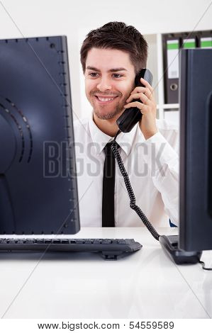 Stock Broker Talking On A Phone