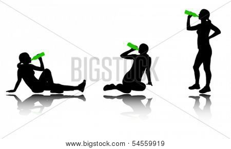 woman drinking water after training silhouettes