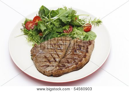 Low-carb meal of grilled rump steak with a home-grown salad mix and cherry tomatoes