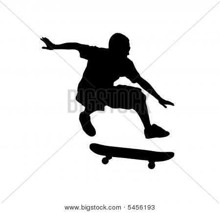 A Silhouette Of A Skateboarder Jumping