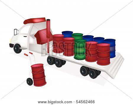Hand Truck Loading Oil Barrels Into Tractor Trailer Flatbed