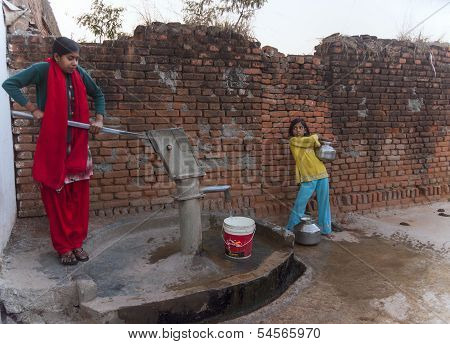 Pumping The Last Pots Of Water From Communal Pump In T