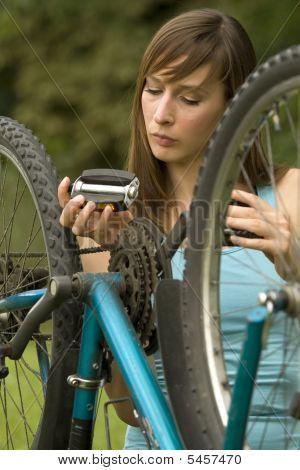 Woman Repairs Bike