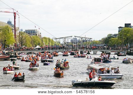AMSTERDAM - APRIL 30: Lots of boats partying on the river Amstel at the celebration of kingsday on April 30, 2012 in Amsterdam, The Netherlands