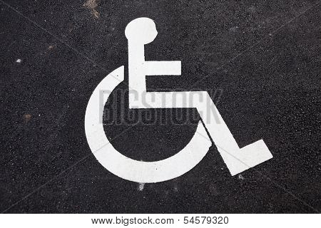 Disabled Sign on asphalt background