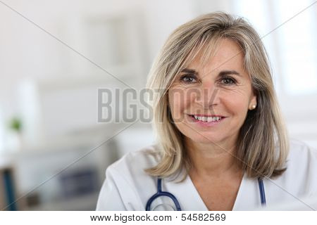 Portrait of smiling senior nurse in hospital