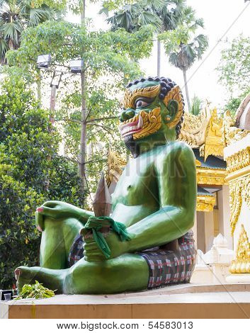 Shwedagon Pagoda Green Demon Statue in Rangoon, Myanmar