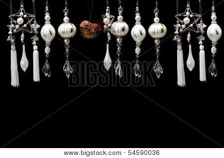 Silver And White Christmas Tree Ornaments On Black