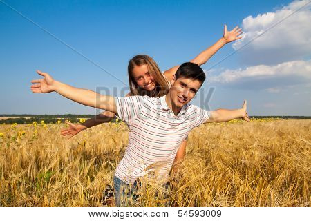 Teen couple on the wheat field