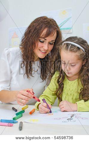 Teacher Helps Little Girl To Draw