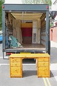 image of rear-end  - Open rear end of moving furniture truck - JPG