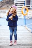 stock photo of little girls photo-models  - Portrait of 4 years old girl walking on berth near sea in the city - JPG
