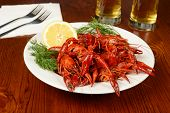 picture of craw  - boiled crayfishes on white plate beer and lemon added - JPG